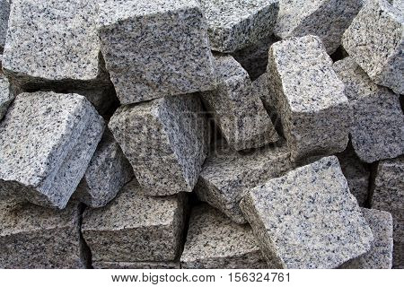 Closeup of a heap of granite paving stones