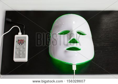 Light rejuvenating mask for facial skin therapy.