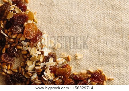 Frame of musli on a grey background with copy space text. Health food concept.