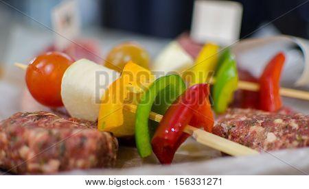 Vegetarian Shish Kebab (barbecue) and raw meat balls