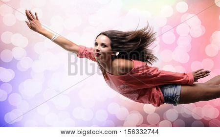 Beautiful woman flying on a abstract background
