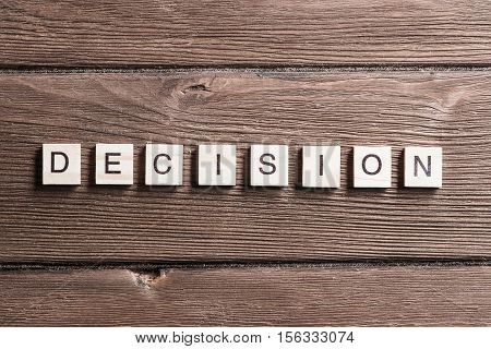 Business decision word collected of elements of wooden elements with the letters