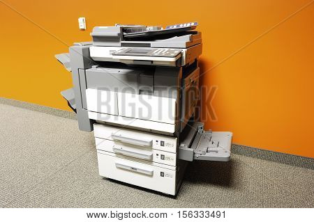 close up on single copier in office