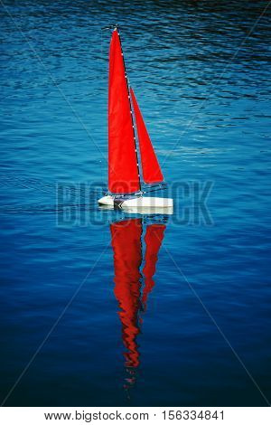 Radio remote control rc sailing yacht boat simulation model in blue water