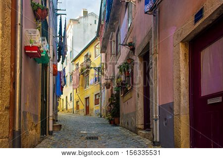 Typical traditional portuguese cobblestone street in Lisbon Portugal