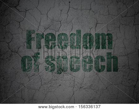 Political concept: Green Freedom Of Speech on grunge textured concrete wall background