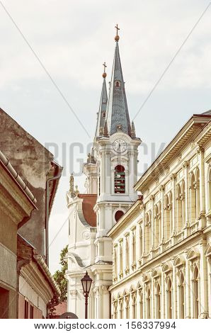 Saint Ignatius church and christian museum in Esztergom Hungary. Religious architecture. Place of worship. Retro photo filter. Travel destination. Cultural heritage.
