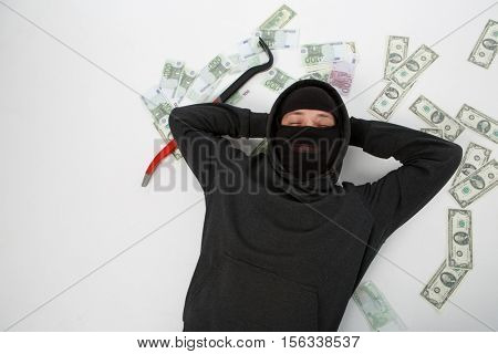 Robber on floor with money