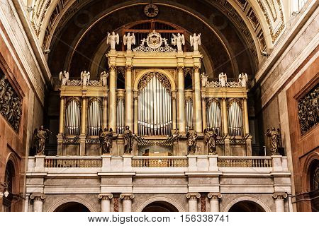 Big organ in Esztergom basilica Hungary. Interior of religious architecture. Place of worship. Cultural heritage. Retro photo filter. Church musical instrument.