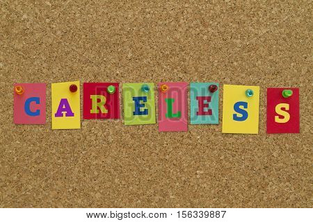 Careless word written on colorful sticky notes pinned on cork board.