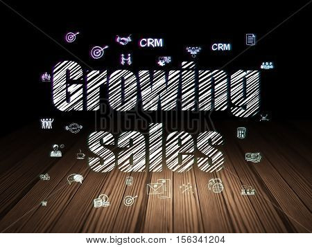 Business concept: Glowing text Growing Sales,  Hand Drawn Business Icons in grunge dark room with Wooden Floor, black background