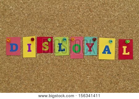 Disloyal word written on colorful sticky notes pinned on cork board.