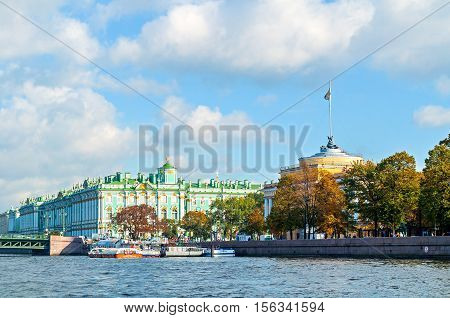 SAINT PETERSBURG RUSSIA-OCTOBER 3 2016. Admiralty arch and Winter Palace or State Hermitage Museum on the embankment of Neva river in Saint PetersburgRussia