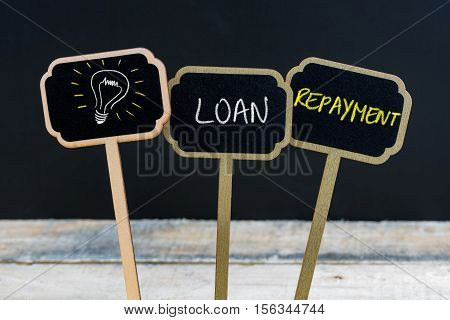 Concept Message Loan Repayment And Light Bulb As Symbol For Idea