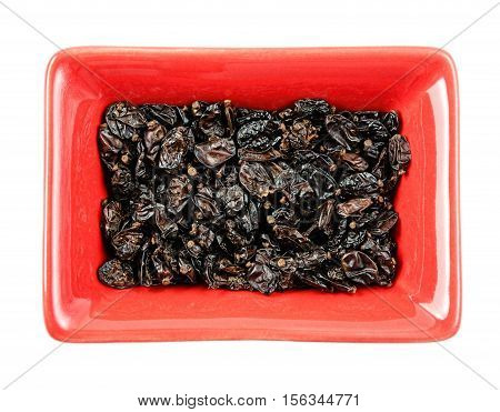 Dried barberry in a bowl. Isolated white background
