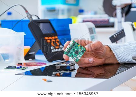 assembly of electronic devices, the use of a soldering iron and other tools