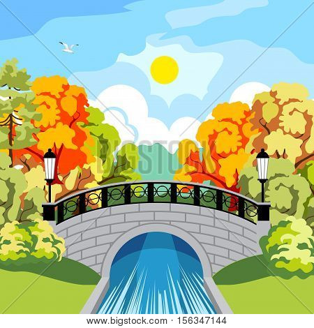 Beautiful park in the fall. Trees with red and yellow foliage. Rapid River. Beautiful antique bridge and cast-iron fence. The black wrought-iron lanterns at the bridge. The bridge reflected in the river. Sun and clouds.