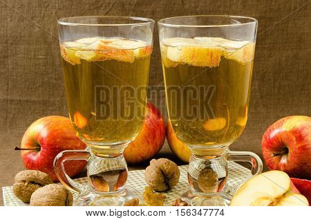 Hot apple cider with apples and slices in cups, warm in winter concept