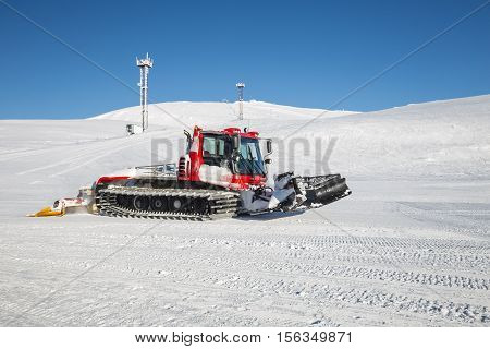 Snow groomer prepares the ski at a ski resort in the Khibiny