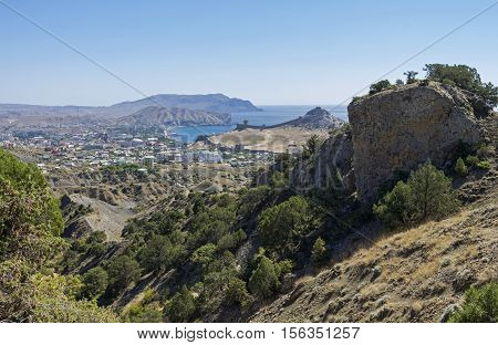 View of the city Sudak and Sudak Bay from the slopes of the surrounding mountains. Crimea September.