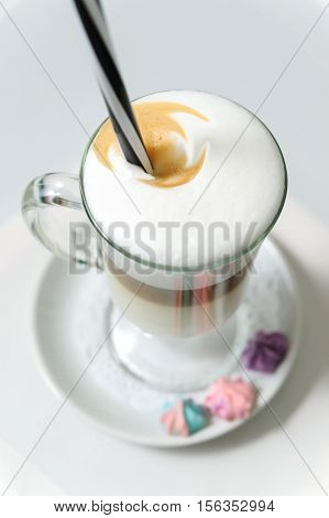 Latte with thick foam in a glass. Top view.