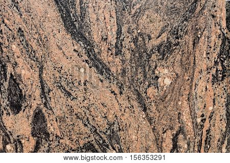 Close up view of a polished granite slab.