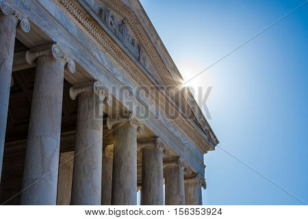 Closeup of gable and columns on Jefferson Memorial with sunburst at roofline