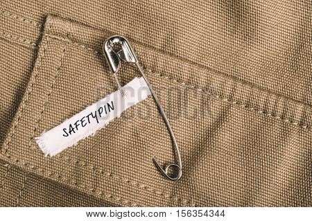 Safety pin on clothes with label