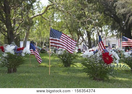 Memorial Day flags placed at the grave sites to pay tribute to fallen servicemen and women who gave their lives in service to our country