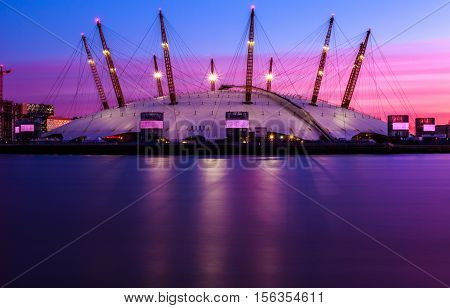 Sunset at the O2 Arena against a purple sky