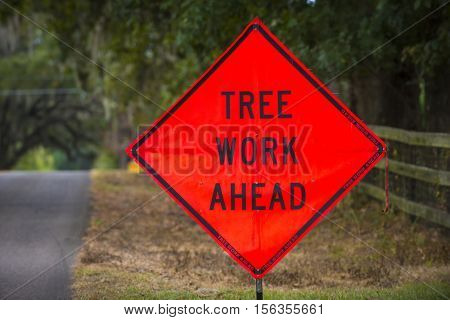 Tree Work Ahead large orange road sign warning caution crew working