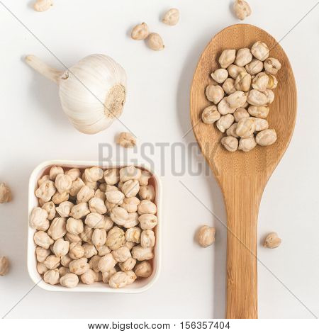 Chick Peas into a bowl isolated on white background