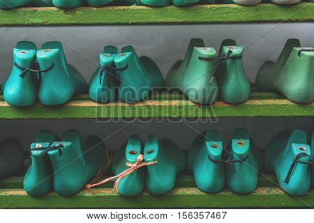 blue and green plastic pads on a wooden shelf