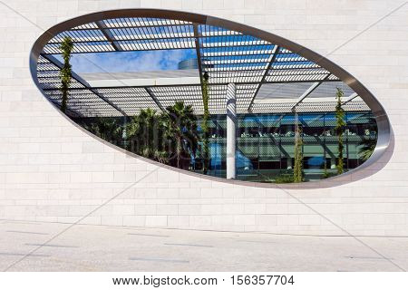 Lisbon, Portugal - October 31, 2016:  Oval window to the interior garden in the Champalimaud Foundation, Centre for the Unknown. Biomedical private research center.