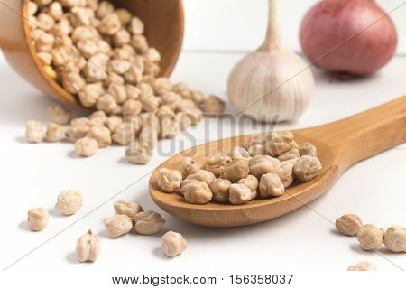 Chick Peas into a spoon isolated on white background