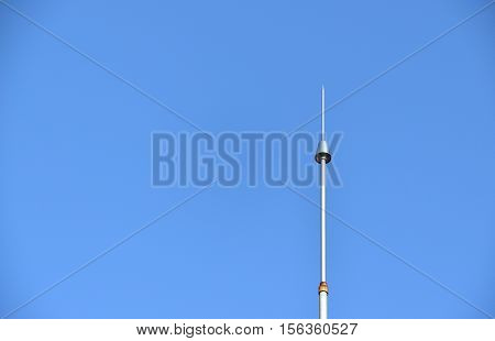 Lightning conductor against the clear blue sky