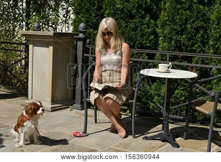 Woman And Dog Relaxing