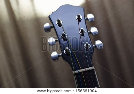 acoustic guitar fretboard and strings of colored