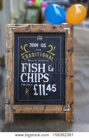 London, the UK - May 2016: Fish and chips restaurant ad