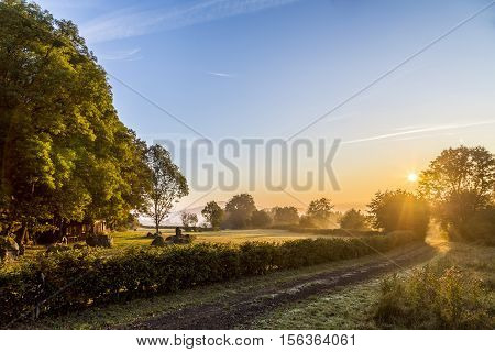 sunrise in Eifel landscape near Daun with bright sky poster