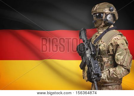 Soldier In Helmet Holding Machine Gun With Flag On Background Series - Germany