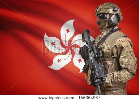 Soldier In Helmet Holding Machine Gun With Flag On Background Series - Hong Kong