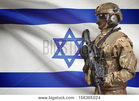 Soldier In Helmet Holding Machine Gun With Flag On Background Series - Israel