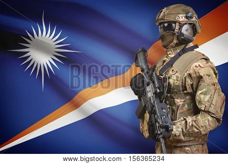 Soldier In Helmet Holding Machine Gun With Flag On Background Series - Marshall Islands