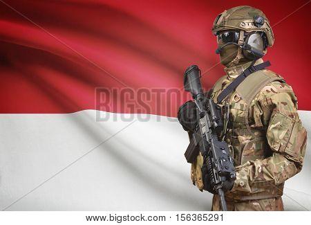 Soldier In Helmet Holding Machine Gun With Flag On Background Series - Monaco