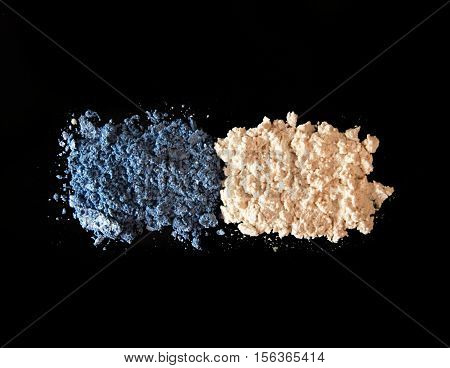 Eye Shadow On Black Background. Blue And  Ivory-coloured Eye Shadow