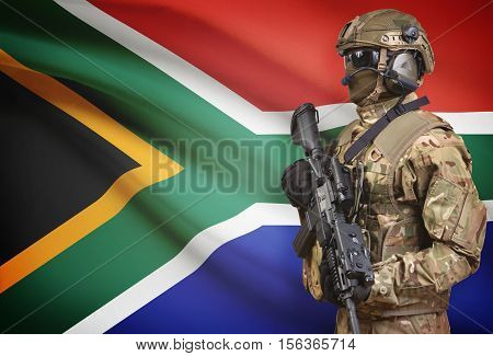 Soldier In Helmet Holding Machine Gun With Flag On Background Series - South Africa