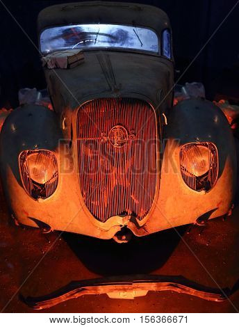 MOSCOW - MAR 07, 2016: Dirty retro car on exhibition Oldtimer-Gallery in Sokolniki Exhibition Center. It is only one in Russia exhibition of vintage cars and technical antiques