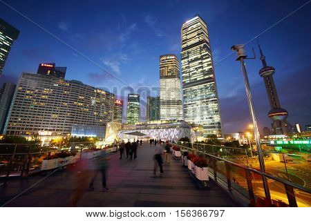 SHANGHAI, CHINA - NOV 6, 2015: Tourists and tall skyscrapers, China tallest skyscraper (Shanghai Tower) height of 630 meters