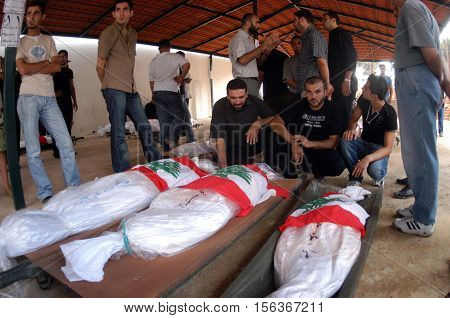 BEIRUT, LEBANON - AUGUST 9 : Funeral for civilians who were killed by Israeli bombs in 2006 on August 9, 2006 in Beirut, Lebanon.